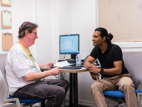 ASRC staff member in meeting with man who is seeking asylum