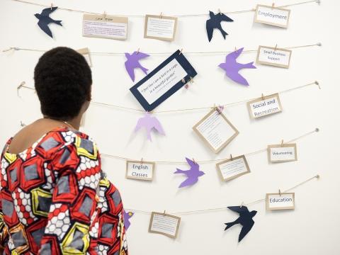Woman looking at womens empowerment program art work