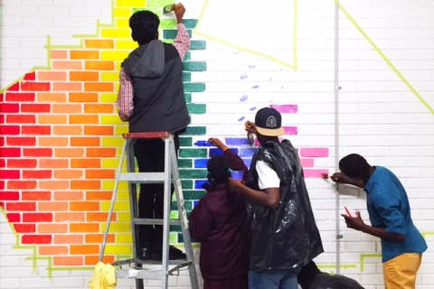 ASRC youth program painting mural