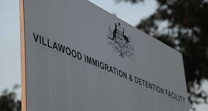 People must be immediately released from immigration detention as another worker tests positive for COVID-19